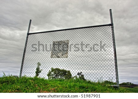 Solitary Fence against cloudy sky - stock photo