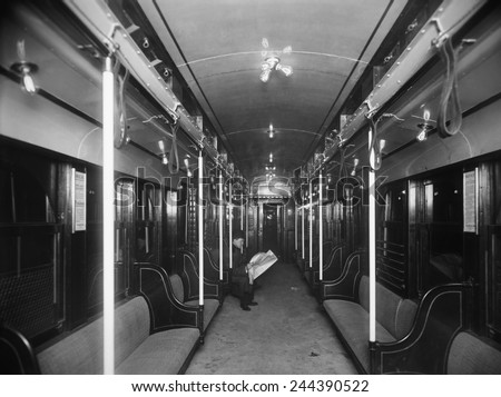Solitary passenger in a commuter train in the new Holland Tunnel under the Hudson River connecting New York City and New Jersey public transit systems. Ca 1927. - stock photo