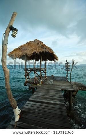 Solitude bridge at the sea. - stock photo