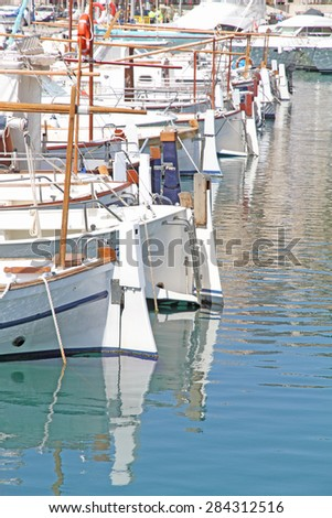 SOLLER SPAIN-APRIL 13: Typical boats in Puerto de Soller on April 13, 2015 in Port of Mallorca with llaut boats  Balearic Islands, Spain - stock photo