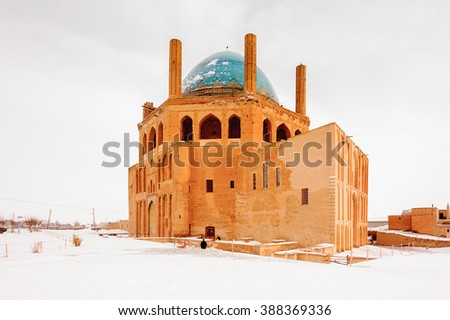 Soltaniyeh dome in winter on the snow, Soltaniyeh District of Abhar County, Zanjan Province, Iran. UNESCO World Heritage - stock photo