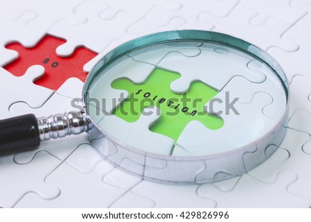 SOLUTION and NO puzzle with magnifier glass - stock photo