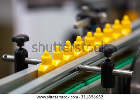 Solution Bottles transfer on Conveyor Belt System - stock photo