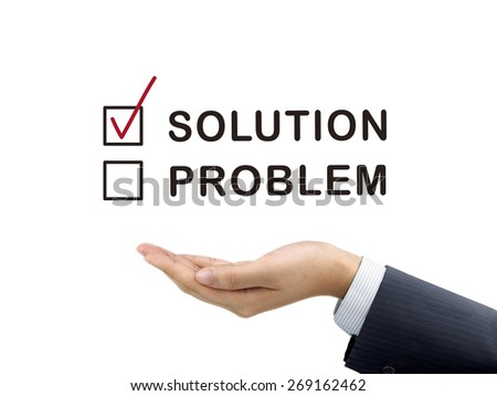 solution chosen by businessman's hand over white background - stock photo