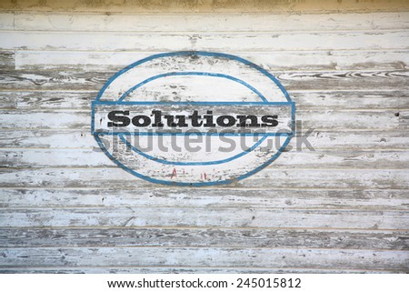 Solution concept - Solution sign on shed side - stock photo
