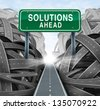 Solutions ahead and business answers concept with a green highway sign as an icon of breaking out from a confusion of tangled roads with a clear strategic path. - stock photo