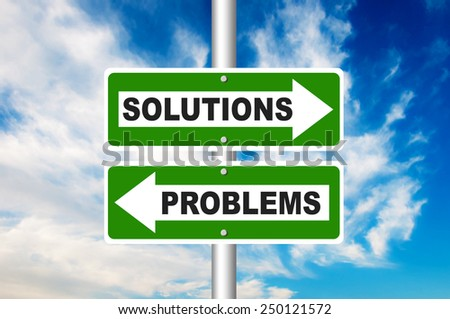 Solutions and Problems two way street road sign with a blue sky in a background - stock photo