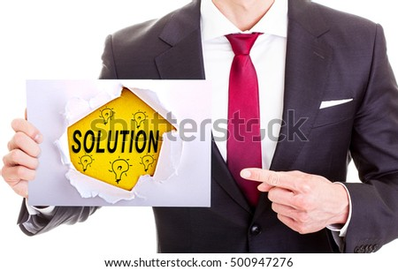 Solutions - Businessman hand holding sign. Business, technology, internet concept. Stock Photo