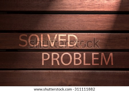 solved problem  text on wooden - stock photo