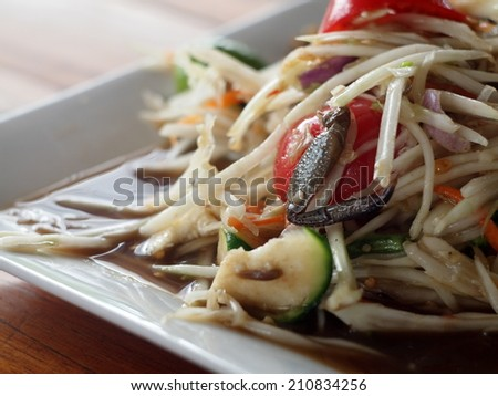 SOM-TAM, Thai delicious raw papaya salad with unique taste hot and spicy, this dish with tomato and crab.   - stock photo