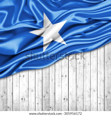 Somalia  flag of silk with copyspace for your text or images and wood background - stock photo