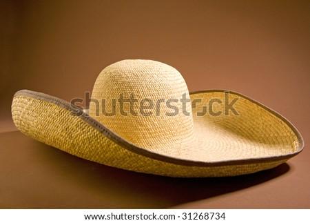 sombrero hat on brown ground - stock photo