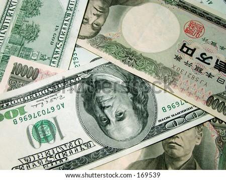 Some American and Japanese bills(100 dollar and 10000 yen) - stock photo