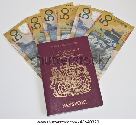 some austalian 50 dollar notes and a passport - stock photo