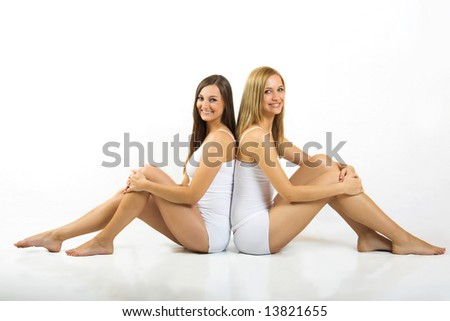 some beautiful women with white underwear are smiling - stock photo