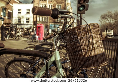 some bicycles locked in a rack in a street in London, United Kingdom - stock photo