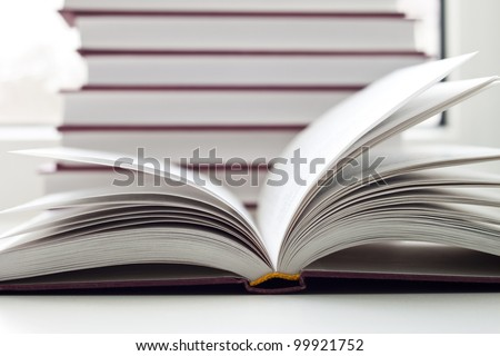 Some books and the opened book - stock photo