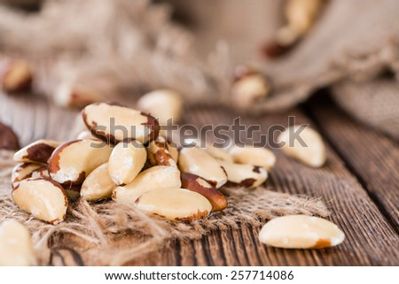 Some Brazil Nuts on vintage wooden background