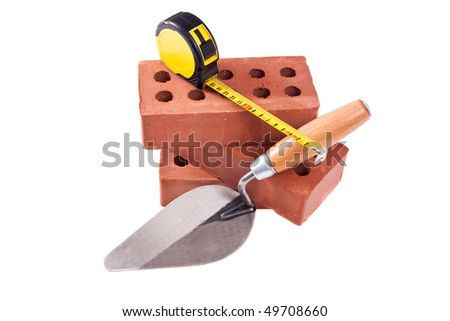 some brick , trowel And meter on isolated white
