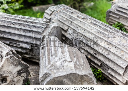 some broken and ancient roman columns ruins - stock photo