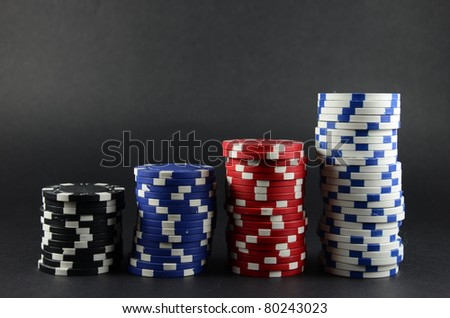Some Casino gambling chips over black background