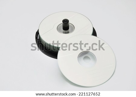 some cd rom stacked over a white background - stock photo