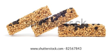 some cereal bars with chocolate chips on a white background - stock photo