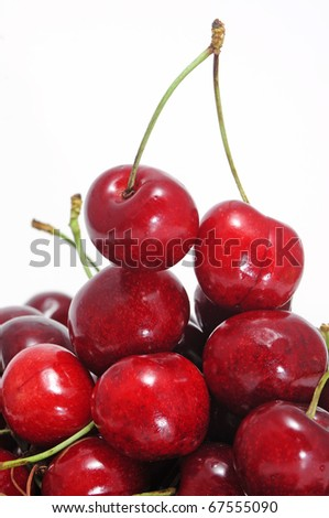 some cherries isolated on a white background