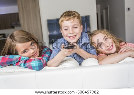 Some child having fun and watching TV at home