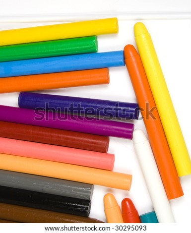 Some children's oil pencils close up on white - stock photo