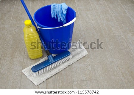 some cleaning products on old floor - stock photo