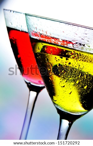 some cocktail glasses with beverages of different colors in a club - stock photo