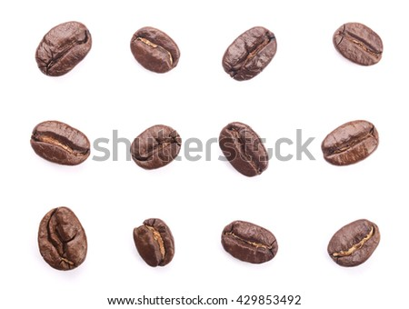 Some coffee beans are isolated on the white background.