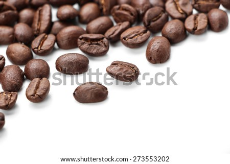 Some coffee beans is isolated on white background with copy space.