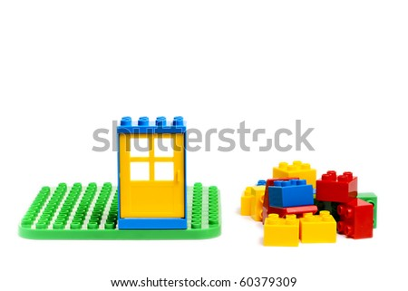 Some colored bricks from game isolated on the white - stock photo