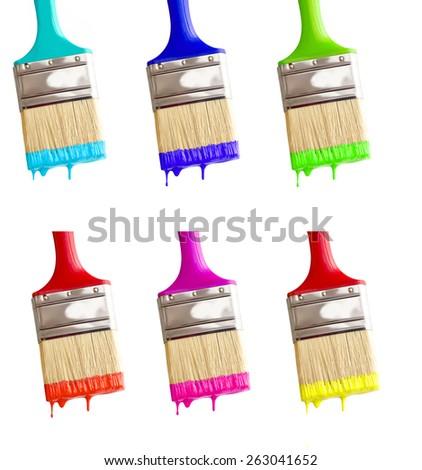 some colored paintbrushes isolated on white macro shot. - stock photo
