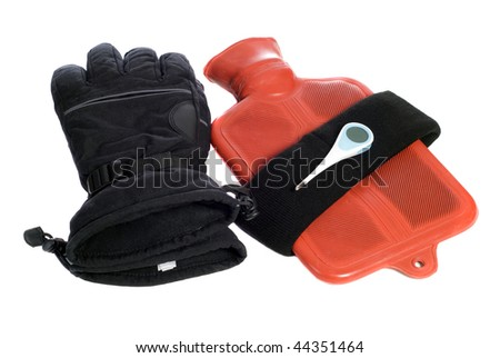Some common objects that keep a body warm are gloves, a headband, and a hot water bottle, along with a thermometer to check the temp, isolated on white - stock photo