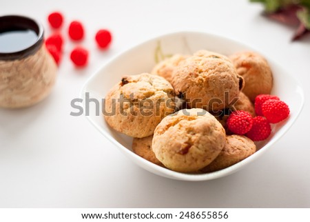 some cookies and candy in a plate - stock photo