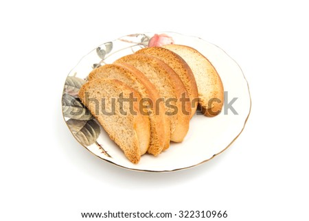 some crackers on glass plate on white background - stock photo