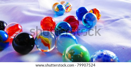 Some crystal balls on a blue background - stock photo