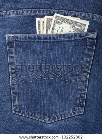 Some dollars in a pocket of jeans - stock photo