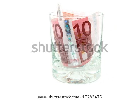 Some euro banknotes in a tumbler isolated on white background