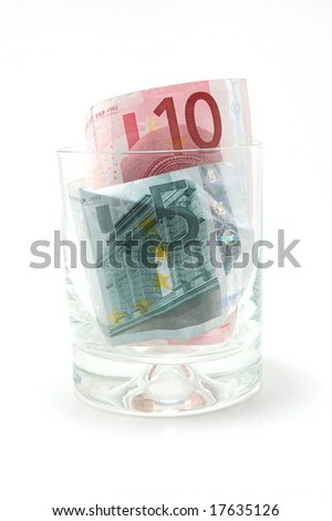 Some euro banknotes in a tumbler isolated on white background - stock photo