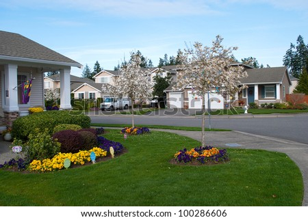 Some family houses in a suburban area in Easter spring time. - stock photo