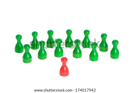 Some figurines in different colors as symbol for teamwork, but also confrontation - stock photo