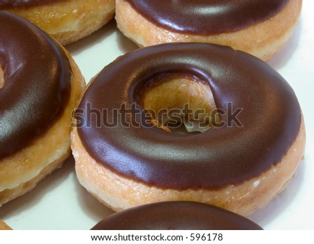 Some fresh donuts still in their box - stock photo