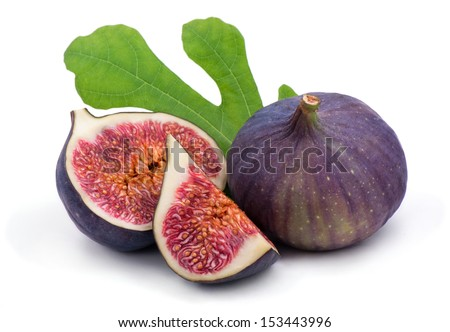Some fresh,juicy figs with green leaves. - stock photo