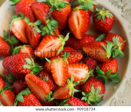 Some fresh strawberries on the plate - stock photo