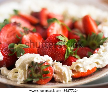 Some fresh strawberries with cream on the plate