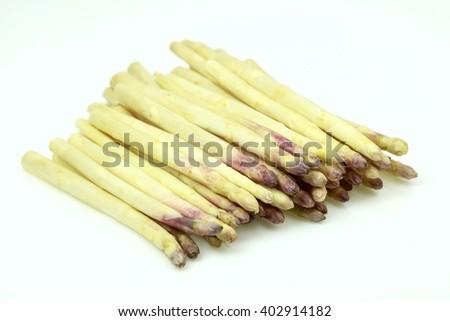 Some fresh white asparagus, on white background. - stock photo
